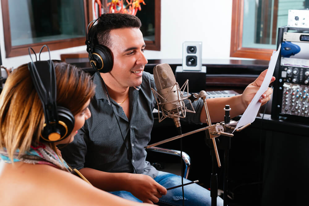 Man and woman recording radio ad